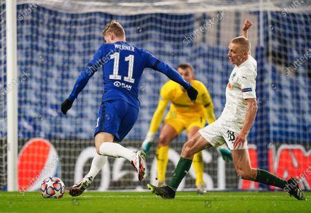 Stock Photo of Timo Werner of Chelsea strikes the ball past Igor Smolnikov of FC Krasnodar