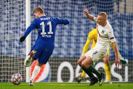 Stock Picture of Timo Werner of Chelsea strikes the ball past Igor Smolnikov of FC Krasnodar
