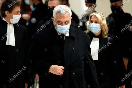 French lawyer Thierry Herzog arrives at the courtroom in Paris. Herzog and Former French President Nicolas Sarkozy go on trial on charges of corruption and influence peddling in a phone-tapping scandal, a first for the 65-year-old politician who has faced several other judicial investigations since leaving office in 2012