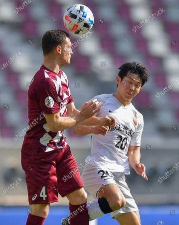 Yang Shiyuan (R) of Shanghai SIPG FC vies with Thomas Vermaelen of Vissel Kobe during the round 16 match of the AFC Champions League between Shanghai SIPG FC of China and Vissel Kobe of Japan in Doha, Qatar, Dec. 7, 2020.