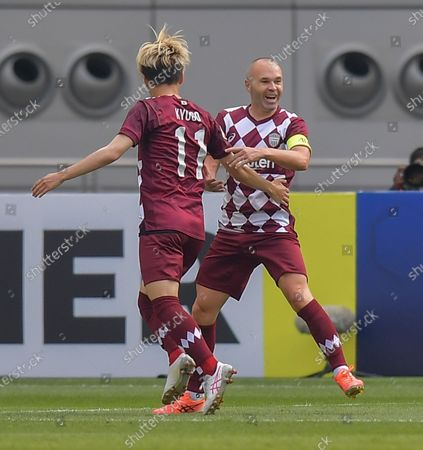 Andres Iniesta (R) of Vissel Kobe celebrates his goal during the round of 16 match of the AFC Champions League between Shanghai SIPG FC of China and Vissel Kobe of Japan in Doha, Qatar, Dec. 7, 2020.