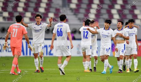 Bluewings goalkeeper Yang Hyung-Mo (L) celebrates with teammates after winning the AFC Champions League Round of 16 match between the Yokohama F. Marinos and the Suwon Samsung Bluewings at the Khalifa International Stadium in Doha, Qatar, 07 December 2020.
