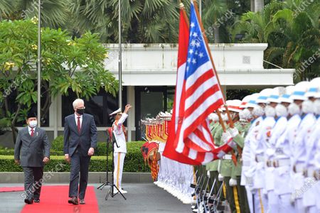 Stock Picture of In this photo released by Indonesian Ministry of Defense, Defense Minister Prabowo Subianto, left, walks with acting U.S. Secretary of Defense Christopher Miller as they inspect honor guards during their meeting in Jakarta, Indonesia, . Miller met with his counterpart in Indonesia on Monday as part of a visit to Asia in which he will push Washington's free and open Indo-Pacific policy