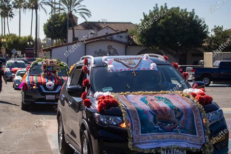 The 89th annual annual walking-turned to car Procession and Mass in honor of Our Lady of Guadalupe arrives at the parking lot of Mission San Gabriel Arcangel on Sunday, Dec. 6, 2020 in San Gabriel, CA. The annual Archdiocese of Los Angeles procession and mass, presided by Archbishop Jose H. Gomez, has been taking place since 1931 in East Los Angeles but this year was held in San Gabriel, beginning at Vincent Lugo Park and proceeding to the San Gabriel Mission. The car procession was followed by a mass afterward at the mission parking lot, where only 100 people were allowed to attend (and live streamed for the rest), The parade/procession in normal years has been attended by 10,000 people. The procession and mass is held the first Sunday of December before the Virgen de Guadalupe Feast Day on Dec. 12. The Virgen De Guadalupe is the patron saint of Mexico. (Allen J. Schaben / Los Angeles Times)