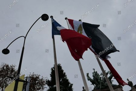 French and Egyptian flags fly next to the Champs Elysées avenue in Paris, . Egyptian President Abdel-Fattah el-Sissi is on a state visit to France, amid criticism from human rights groups over the Egyptian leader's crackdown on dissent