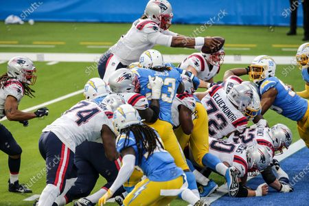 Inglewood, CA, Sunday, December 6, 2020 - New England Patriots quarterback Cam Newton (1) jumps over the line to score a first quarter touchdown against the Chargers at SoFi Stadium. (Robert Gauthier/ Los Angeles Times)