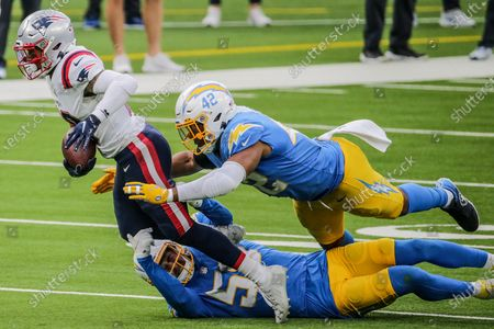 Stock Picture of Inglewood, CA, Sunday, December 6, 2020 - New England Patriots quarterback Cam Newton (1) is brought down by Los Angeles Chargers outside linebacker Kenneth Murray (56) and Los Angeles Chargers linebacker Uchenna Nwosu (42) at SoFi Stadium. (Robert Gauthier/ Los Angeles Times)