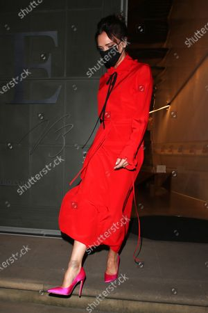 Victoria Beckham is seen leaving her store in London.