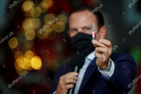 The Governor of Sao Paulo, Joao Doria, shows a vial of 'Coronavac' during a press conference about his vaccination program against covid-19, in Sao Paulo, Brazil, 07 December 2020. Doria announced this Monday at the Palacio de los Bandeirantes, in Sao Paulo, that on 25 January 2021 the vaccination against covid-19 will begin in that state of Brazil, the most populous in the country, with some 46 million inhabitants and epicenter of the pandemic in the South American giant. As long as it gets the go-ahead from the Brazilian health regulator, health professionals, people over 75 years of age and the indigenous and quilombola population will be the first to receive the 'Coronavac'.