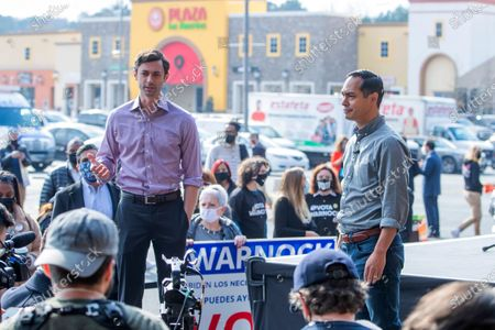 Democratic Georgia US Senate candidate Jon Ossoff (L) campaigns with former US Housing and Urban Development Secretary Julian Castro (R) at Plaza Las Americas in Lilburn, Georgia, USA, 07 December 2020. The pair was urging Latino voter participation on the last Georgia citizens can register to vote for the runoff election. Ossoff is running against Republican Senator David Perdue in a 05 January 2021 runoff election.