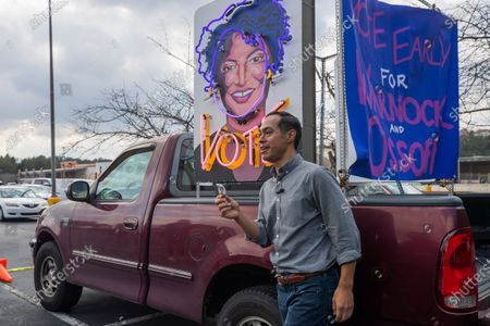 Former US Housing and Urban Development Secretary Julian Castro poses by a large likeness of voting rights advocate Stacey Abrams while campaigning on behalf of Democratic Georgia US Senate candidate Jon Ossoff at Plaza Las Americas in Lilburn, Georgia, USA, 07 December 2020. The pair was urging Latino voter participation on the last Georgia citizens can register to vote for the runoff election. Ossoff is running against Republican Senator David Perdue in a 05 January 2021 runoff election.