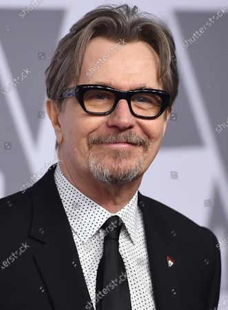 """Gary Oldman arrives at the 90th Academy Awards Nominees Luncheon in Beverly Hills, Calif., on . Oldman, 62, portrays Herman Mankiewicz, who wrote """"Citizen Kane"""" before drinking himself to death at the age of 55, in the David Fincher film """"Mank"""