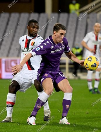 Stock Image of Fiorentina's forward Dusan Vlahovic (R) against Genoa's defender Cristian Zapata (L)  during the Italian Serie A soccer match between ACF Fiorentina and Genoa CFC at the Artemio Franchi stadium in Florence, Italy, 07 December 2020.