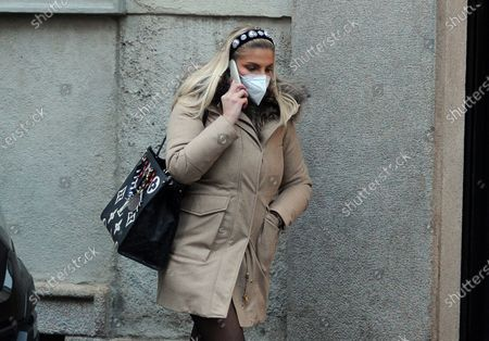 Stock Image of Francesca Cipriani walks through the streets of the center while talking on her cell phone