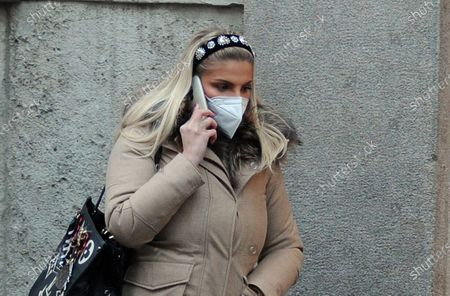 Francesca Cipriani walks through the streets of the center while talking on her cell phone