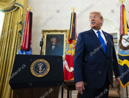 United States President Donald Trump takes questions about the election and the health of Rudy Giuliani after presenting the Medal of Freedom to Dan Gable, a two-time NCAA Division I national champion, a world gold medalist, and an Olympic gold medalist, in the in the Oval Office of the White House in Washington, DC,.