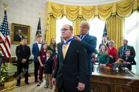 United States President Donald Trump presents the Medal of Freedom to Dan Gable, a two-time NCAA Division I national champion, a world gold medalist, and an Olympic gold medalist, in the in the Oval Office of the White House in Washington, DC,. Afterwards he took questions about the election and the health of Rudy Giuliani.