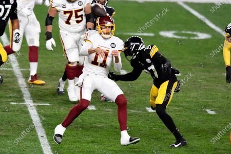 Washington Football Team quarterback Alex Smith (11) gets off a pass before he is hit by Pittsburgh Steelers safety Marcus Allen (27) during the first half of an NFL football game in Pittsburgh