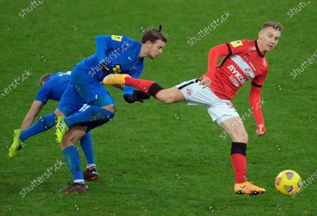 Stock Image of Russian Premier League (RPL). Tinkoff - Russian Football Championship 2020/2021. 17th round. Spartak (Moscow) vs Tambov (Tambov) at the Otkrytie Arena stadium. Tambov player Sebastian Thiel (center) and Spartak player Nail Umyarov (right) during the match.December 05, 2020. Russia, MoscowPhoto credit: Dmitry Lebedev/Kommersant