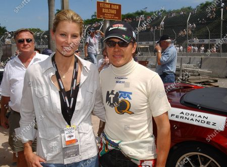 2003 Champ Car Series 26-28 Sept 2003 Grand Prix of the Americas. Miami, Florida. Super model, Nikki Taylor with Adrian Fernandez. 2003- Dan R. Boyd USA LAT Photographics