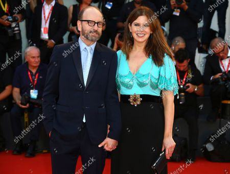 "Director Steven Soderbergh, left, and Jules Asner arrive at the premiere of ""The Laundromat"" at the 76th edition of the Venice Film Festival, Venice, Italy, on . Soderbergh's likes to call his latest film ""the boat movie."" The central conceit of his new HBO Max film ""Let Them All Talk"" was to film it mostly on an eight-day Transatlantic crossing on the Queen Mary 2 ocean liner. Along with the cast of Meryl Streep, Dianne Wiest and Candice Bergen, Soderbergh used the passengers as extras and the ship as a $750 million movie set"
