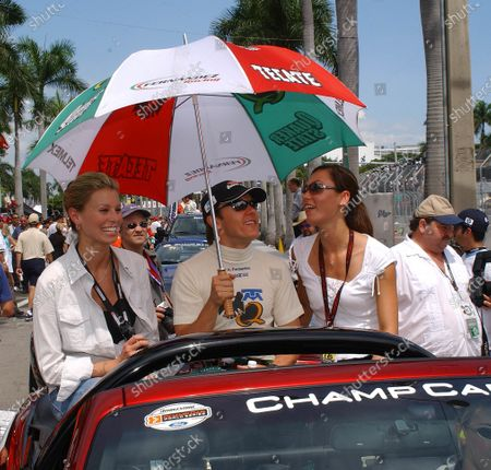 2003 Champ Car Series 26-28 Sept 2003 Grand Prix of the Americas. Miami, Florida. Adrian Fernandez joined by super model, Nikki Taylor for driver's parade. 2003- Dan R. Boyd USA LAT Photographics