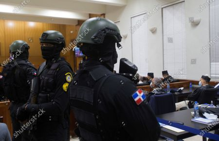 Police officers guard the interior of a hearing on the case of an alleged corruption structure of the previous government that would have managed to steal 81 million dollars from the public treasury, in Santo Domingo, Dominican Republic, 07 December 2020. A week earlier, the Prosecutor's Office launched an operation against officials of the previous government and state suppliers, which led to the arrest of ten people, including two brothers of former President Danilo Medina; Juan Alexis Medina and Carmen Magalys Medina.