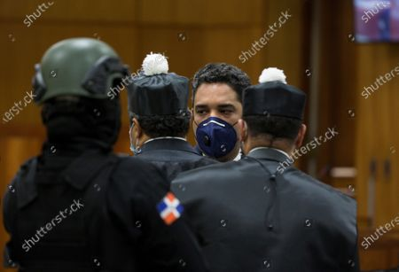 Julian Esteban Suriel Suazo, accused by the prosecution of being a front man for Alexis Medina, brother of former Dominican President Danilo Medina (2012-2020), attends a hearing on the case of an alleged corruption structure of the previous government that would have managed to steal 81 million dollars from the public treasury, in Santo Domingo, Dominican Republic, 07 December 2020. A week earlier, the Prosecutor's Office launched an operation against officials of the previous government and state suppliers, which led to the arrest of ten people, including two brothers of former President Danilo Medina; Juan Alexis Medina and Carmen Magalys Medina.