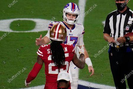 Stock Photo of San Francisco 49ers cornerback Richard Sherman (25) greets Buffalo Bills quarterback Josh Allen (17) prior to the coin toss at the start of an NFL football game, in Glendale, Ariz