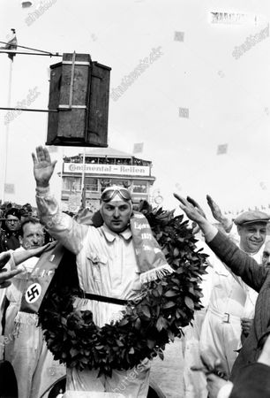 Nurburgring, Germany. 21 May 1939. Hermann Lang (Mercedes-Benz W154), 1st position, podium, portrait.  World Copyright: Robert Fellowes/LAT Photographic Ref: 39EIFRF