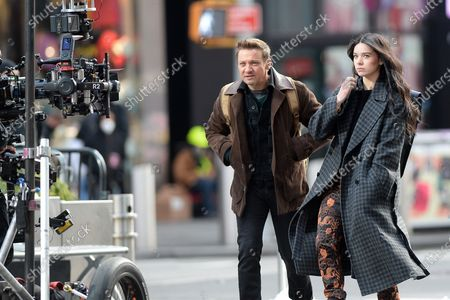 Jeremy Renner and Hailee Steinfeld on location filming 'Hawkeye' in Times Square in New York City.