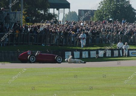 2005 Goodwood Revival Meeting Goodwood, West Sussex. 16th - 18th September 2005 Goodwood Trophy. Willie Green (Maserati 4CLT) lies on the track as his car drives towards him. World Copyright: Jeff Bloxham/LAT Photographic Digital Image Only