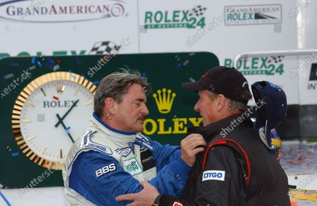 2004 Rolex 24 @ Daytona, Daytona International Speedway, Daytona, Florida, U.S A. January 29 - February 1, 2004 Close competitor, and nearly the winner, except for some very bad luck, Max Crawford congratulates the winning team owner, Jim Bell of Bell Motorsports. C: 2004, Denis L. Tanney, U.S A. LAT Photographic