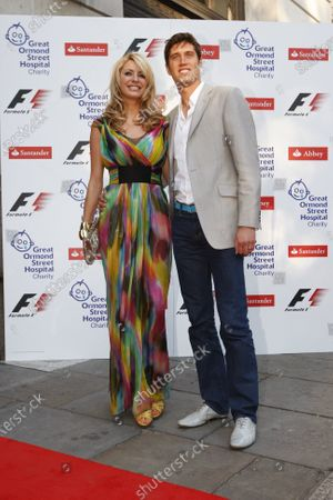 The Formula One Party, sponsored by Santander in aid of Great Ormond Street Hospital. Bloomsbury Ballroom, London. 2nd July 2008. Tess Daley and Vernon Kaye. Portrait.  Photo: Glenn Dunbar / LAT Photographic