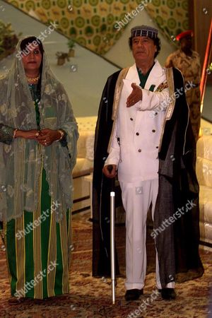 Stock Picture of Meeting Of The Organisation Of African Unity (oau) Foreign Ministers In Tripoli 06 September 1999  Colonel Muammar Gaddafi And His Wife Safia On First Day Of Africa Summit In Tripoli