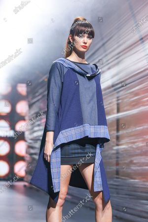 A model wearing Zoran Aragovic fashion collection on the catwalk at the Bipa Fashion.hr fashion show in Zagreb, Croatia.