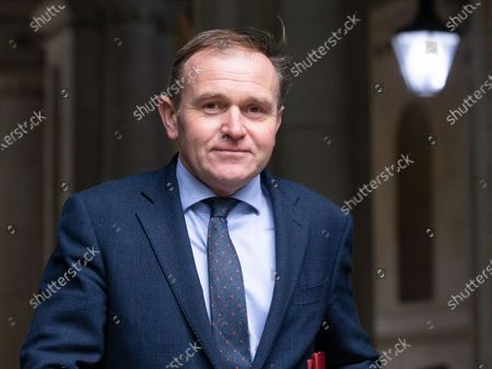 George Eustice, Secretary of State for Environment, Food and Rural Affairs, leaves the Cabinet meeting.