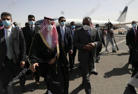 Sudanese acting Foreign Minister Omar Qamar al-Din, center right, welcomes Saudi Foreign Minister Prince Faisal bin Farhan, third on left, upon his arrival to Khartoum Airport. in Khartoum, Sudan, . The prince's visit is the first by the Kingdom's top diplomat since Sudan's military overthrew former autocratic leader President Omar al-Bashir last year