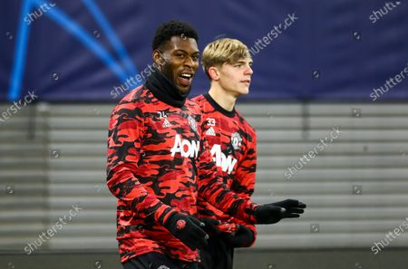 Timothy Fosu-Mensah of Manchester United and Brandon Williams of Manchester United warm up
