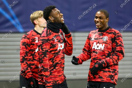 Timothy Fosu-Mensah of Manchester United and Odion Ighalo of Manchester United warm up