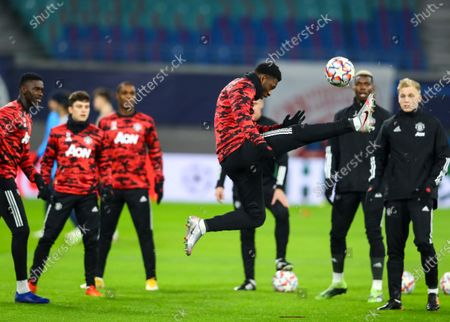 Timothy Fosu-Mensah of Manchester United warms up