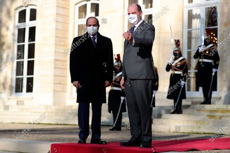 "French Prime Minister Jean Castex, right, welcomes Egyptian President Abdel-Fattah el-Sissi prior to their talks in Paris, Tuesday, Dec.8, 2020. French President Emmanuel Macron acknowledged Monday ""disagreements"" with Egyptian President Abdel-Fattah el-Sissi over human rights, but said it will not prevent France from reaching economic and defense deals with the North African country, which has seen the heaviest crackdown on dissent in its modern history"