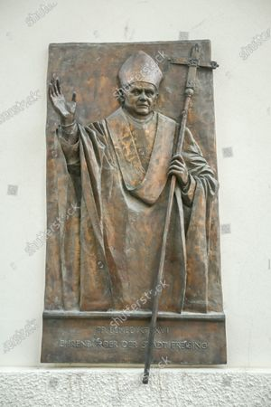A wall sculpture of Pope Benedict XVI on Saint Mary and Corbinian Cathedral  in Freising, Germany.