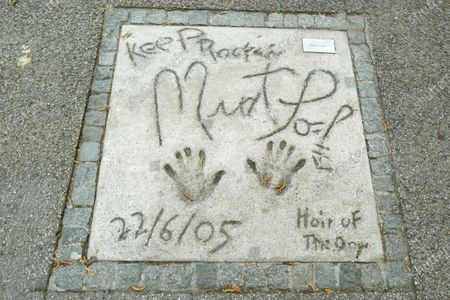 Stock Photo of A view of the Meat Loaf handprints and signature in concrete at the Munich Olympic Walk Of Stars in Olympic Park in Munich, Germany.