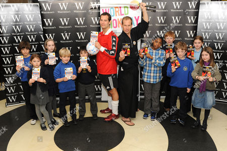 Stock Picture of Jamie Johnson and Chris Bradford with schoolchildren
