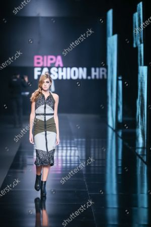 Fashion model wearing clothes for autumn-winter, designed by AnaBo. by Ana Bogdan on the Bipa Fashion.hr fashion show in Zagreb, Croatia.