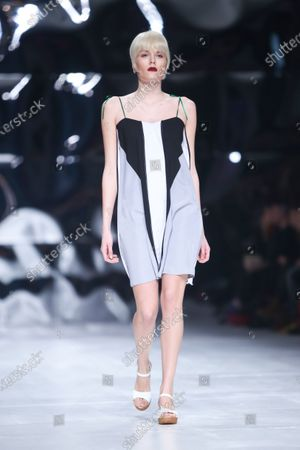 Stock Photo of Model wearing clothes designed by Hedra Design on the Bipa Fashion.hr fashion show in Zagreb,Croatia.HEDRA Design is a clothing and accessories fashion brand by Ana Jagic.