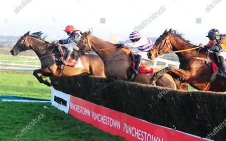 PUNCHESTOWN HOKE COLBURN and Philip Enright (far) beat Chosen Hour (centre) and Chief Of Police (near) to win the Barry Geraghty Autobiography True Colours Handicap Steeplechase. Healy Racing