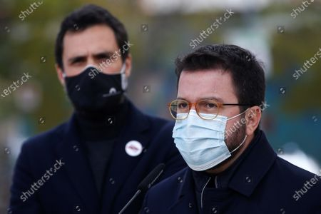Catalan regional Deputy President Pere Aragones (R) talks to media next to Catalan Parliament Speaker Roger Torrent as they leave Wad-Ras prison after they met with imprisoned former Catalan Parliament Speaker Carme Forcadel in Barcelona, northeastern Spain, 08 December 2020. Catalan pro-independent party ERC's member Pere Aragones announced that their party mates Laura Vilagra (unseen) and Roger Torrent will run in upcoming regional election, next 14 Feburary, in the position two and three of the party's candidate list.