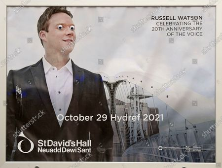 Advert outside St David's Hall in Cardiff City Centre for Russell Watson concert next year. Someone has placed googly eyes over his eyes on the poster